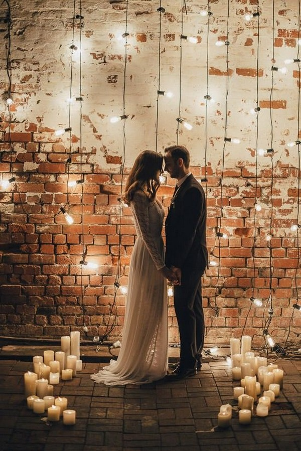 industrial wedding backdrop ideas with lights and candles