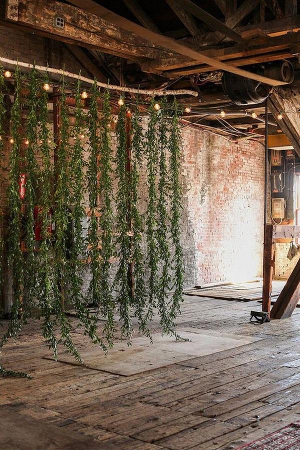 industrial wedding ceremony venue with greenery backdrop