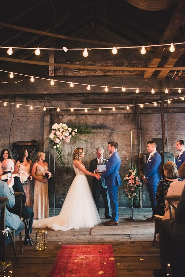 industrial wedding venue with string lights