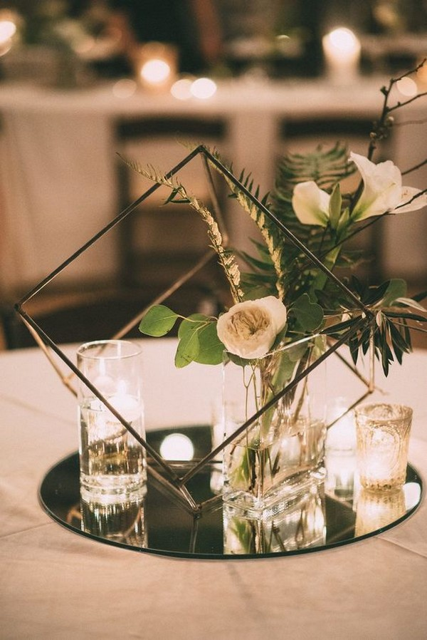 modern wedding centerpiece ideas with black geometric sphere