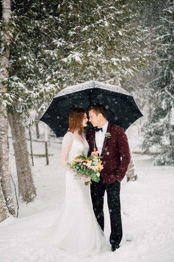 romantic winter wonderland wedding photo ideas with umbrella