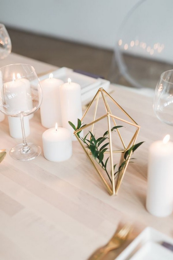 simple chic wedding centerpiece with candles and geometric sphere