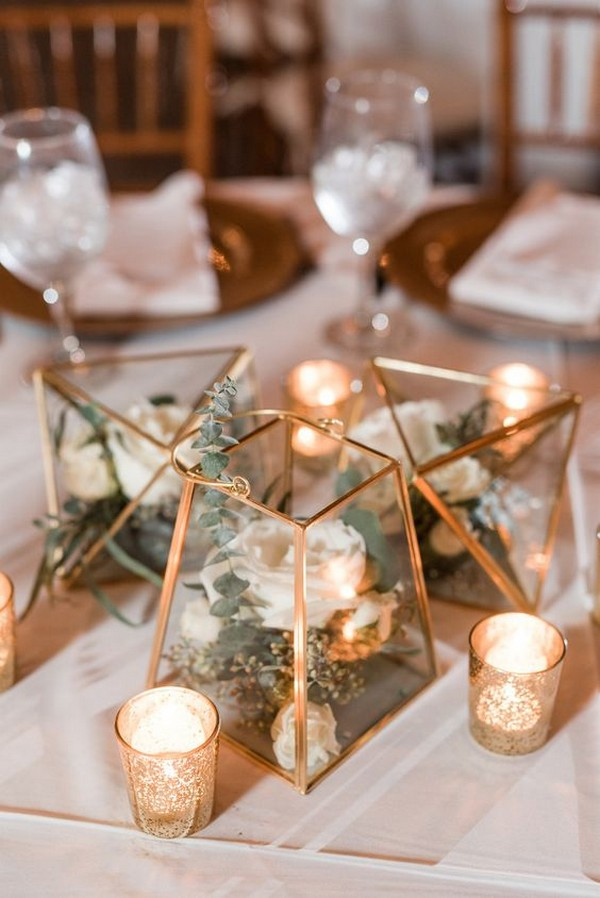 trending wedding centerpiece ideas with gold geometric terrarium and candles