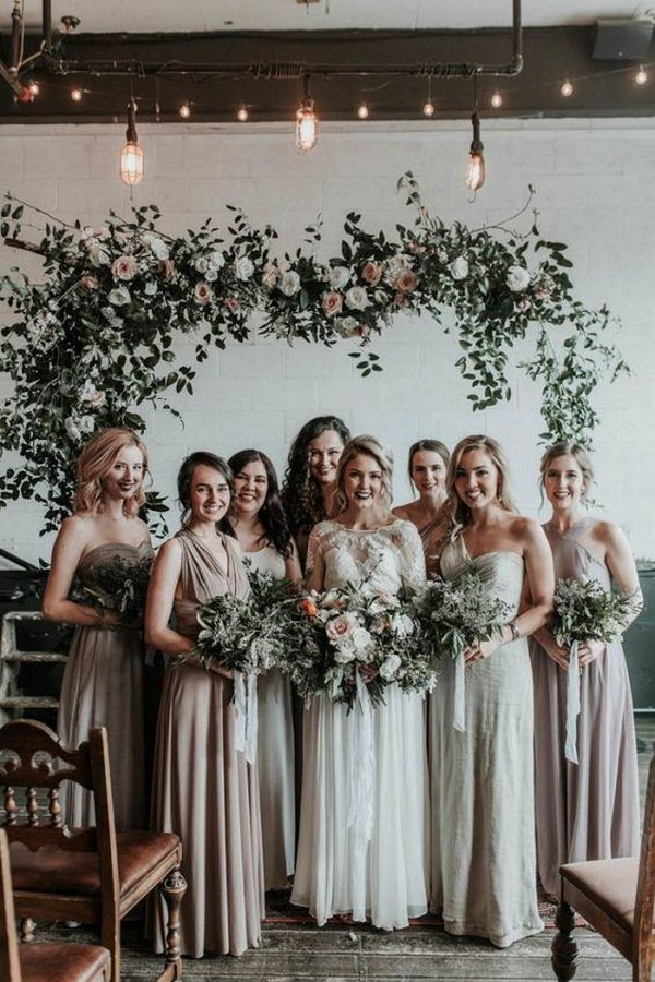 Mismatched neutral bridesmaid dresses in grey, taupe and blush