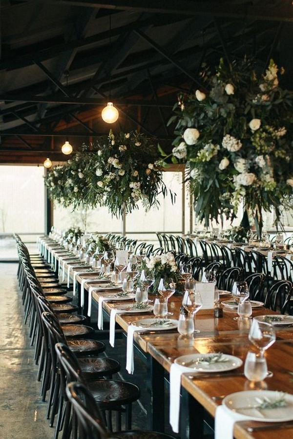 White and green flower chandeliers at winery wedding reception
