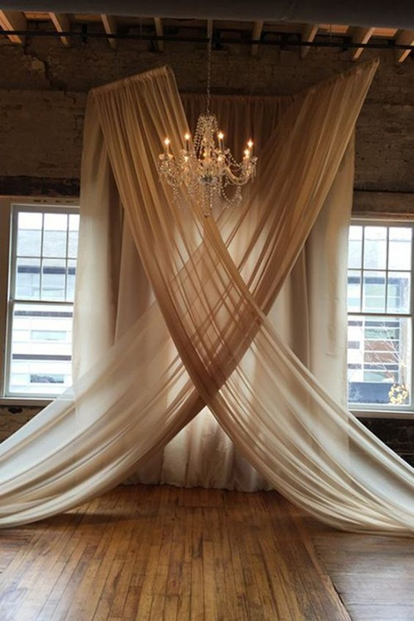 backdrop with hung voile in champagne for loft wedding ceremony