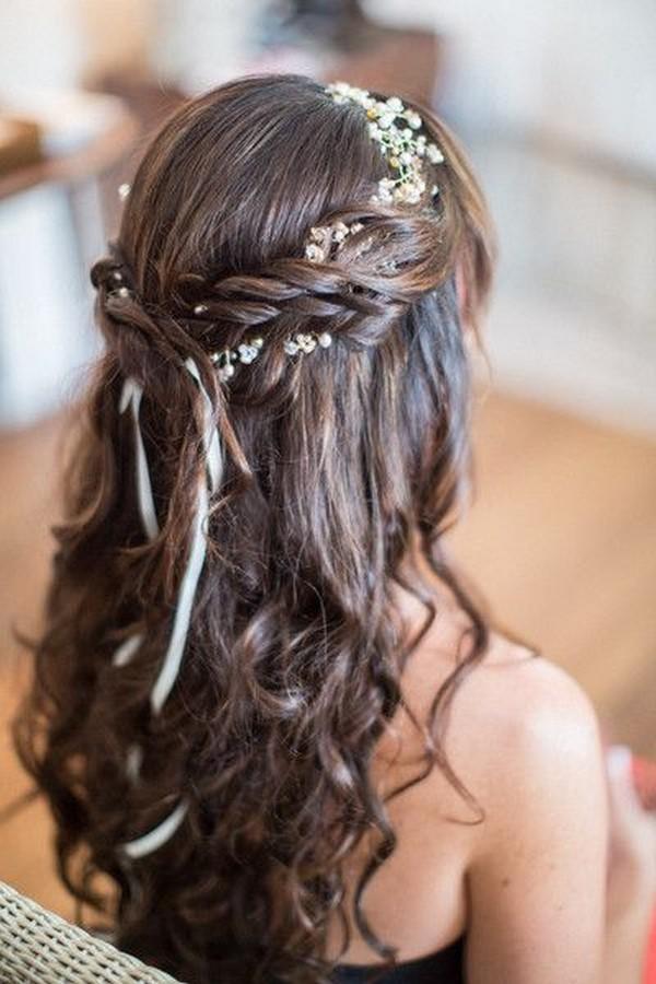 braided half up half down wedding hairstyle with flower crown