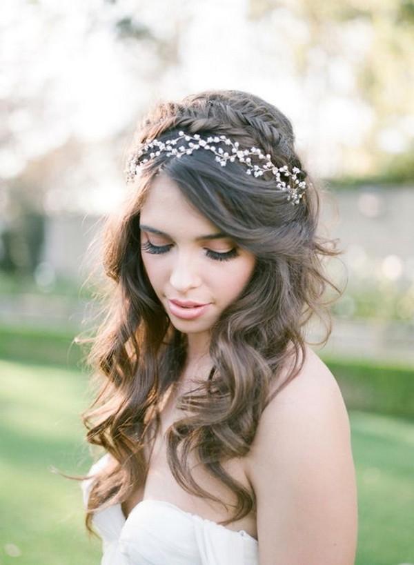 braided half up half down wedding hairstyle with headpiece