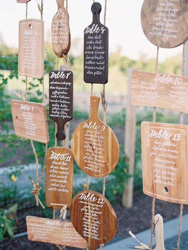 calligrapied cutting boards wedding seating chart display