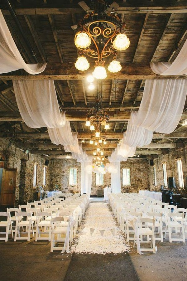 chic loft wedding ceremony decoration ideas with lights and fabric draping
