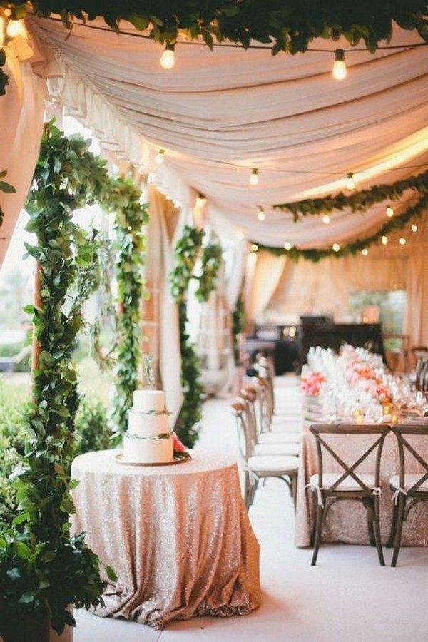 chic tented wedding reception with lights and greenery