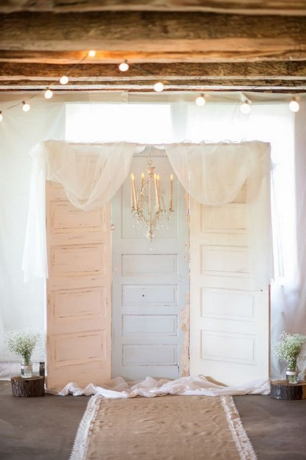chic vintage wedding photo booth backdrop with old doors