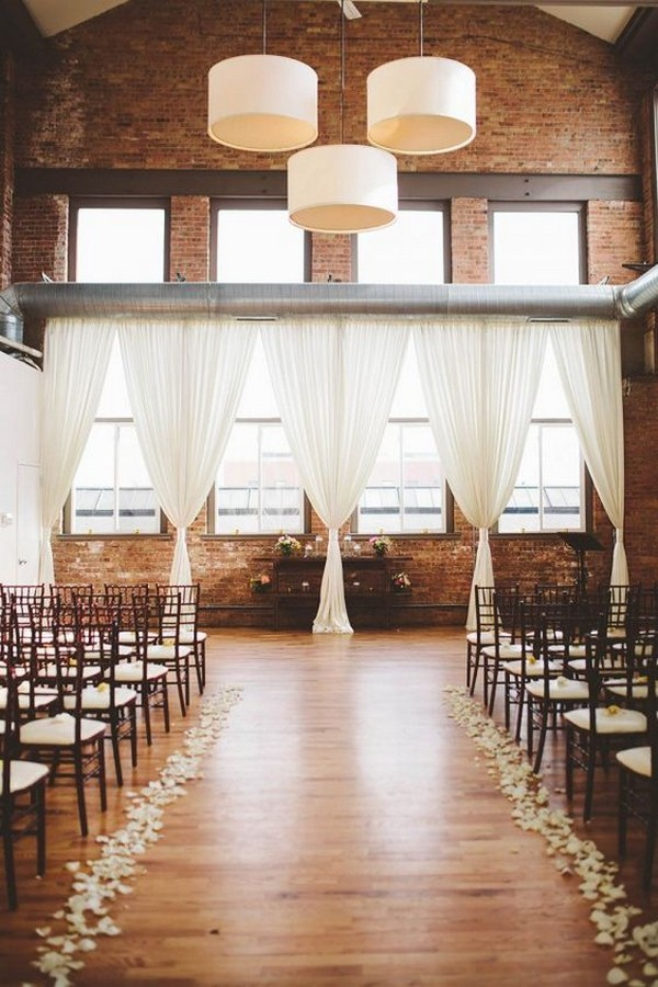 chic wedding ceremony with fabric draping at City View Loft