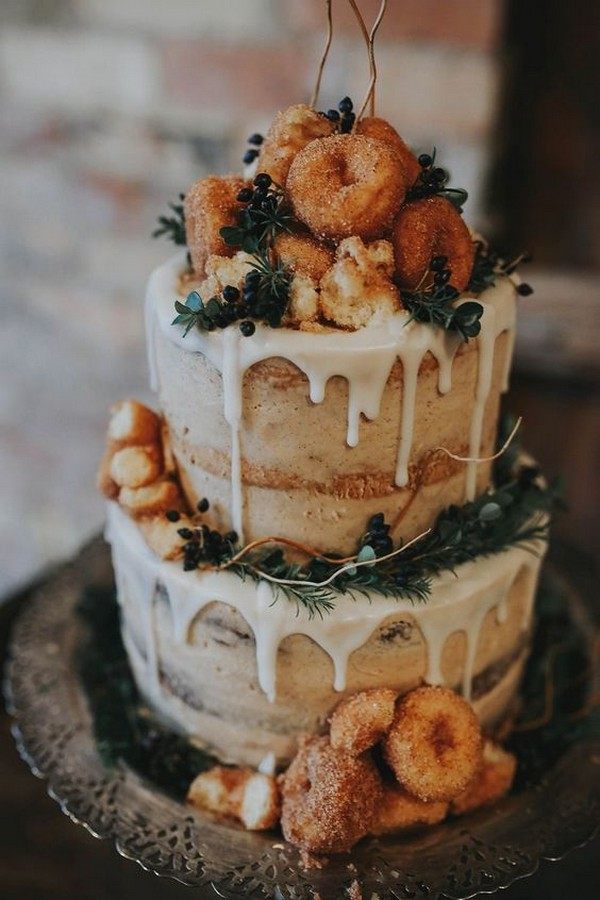 creative wedding cake covered with donuts