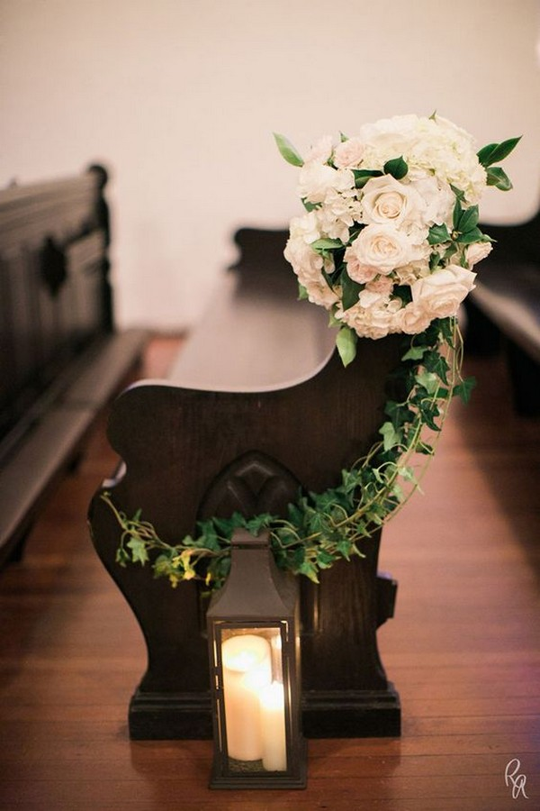 elegant flower and candle decorated church pew wedding ideas