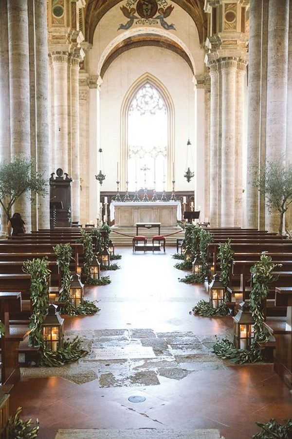 greenery and lantern church wedding aisle