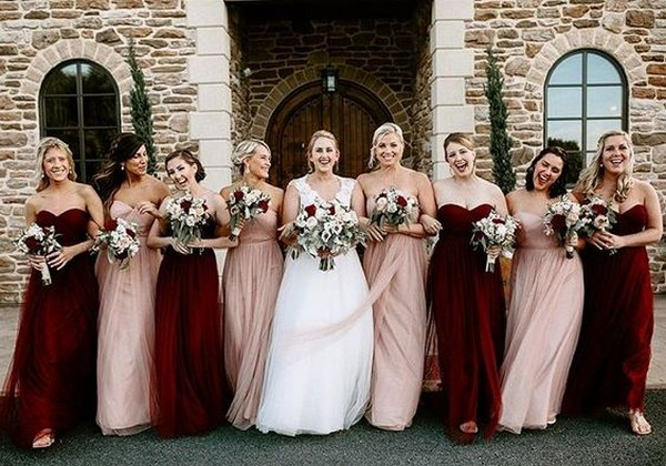 mismatched bridesmaid dresses in blush and burgundy