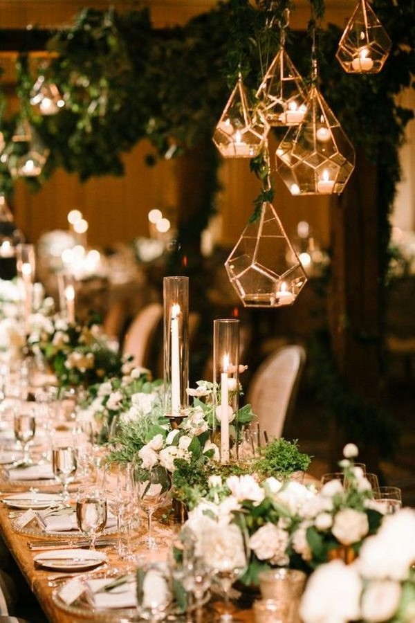 modern wedding reception with geometric lights and greenery