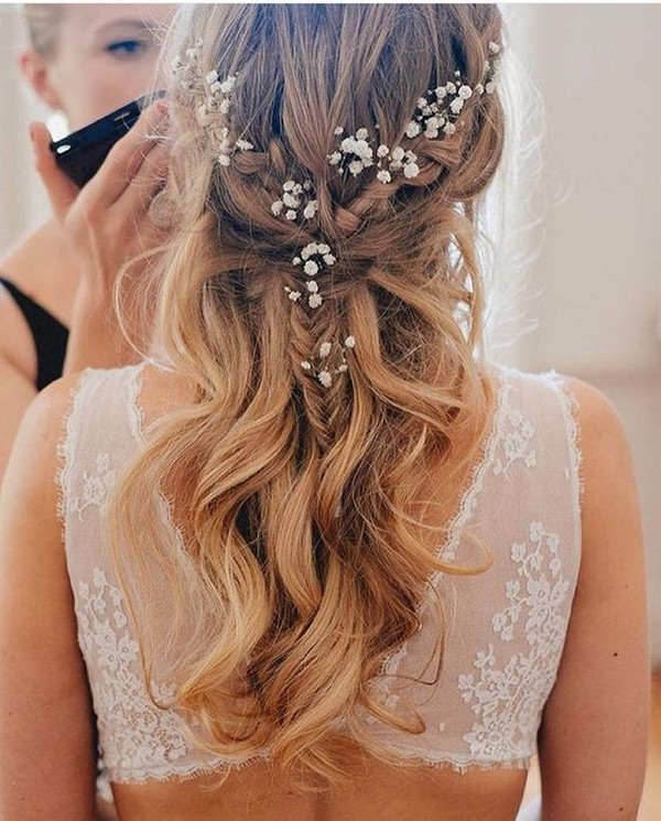 pretty half up half down wedding hairstyle with baby's breath