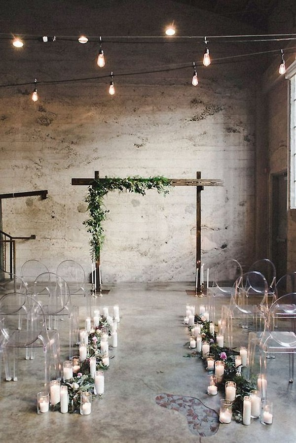 simple chic loft wedding ceremony with candles and greenery