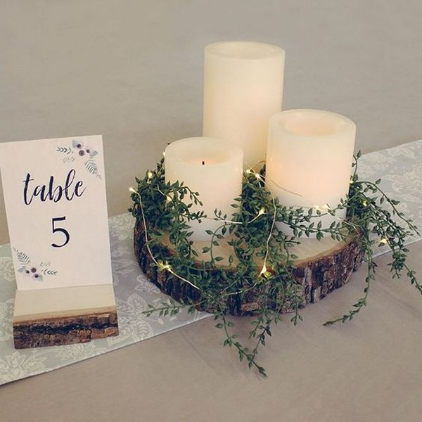 simple elegant wedding centerpiece with candles and lights