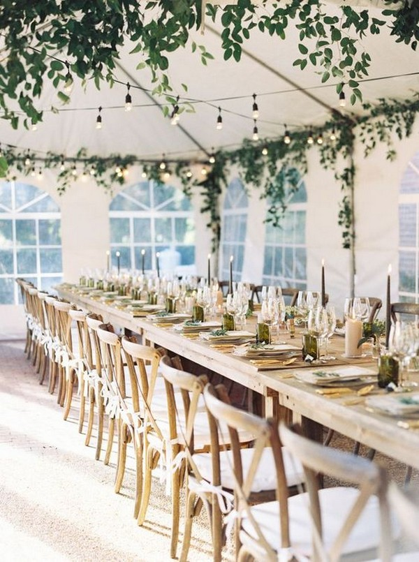 tent wedding reception with hanging greenery and lights