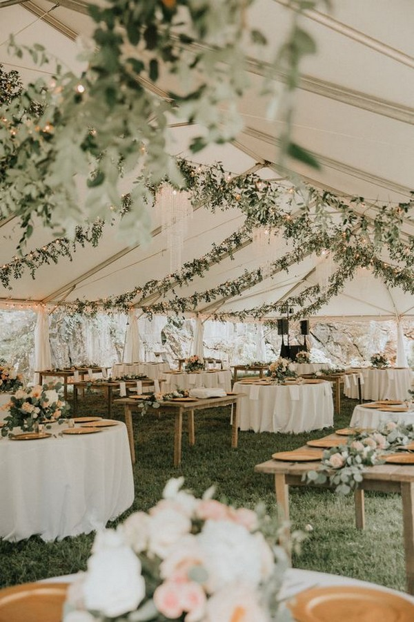 tented wedding reception ideas with lights and greenery