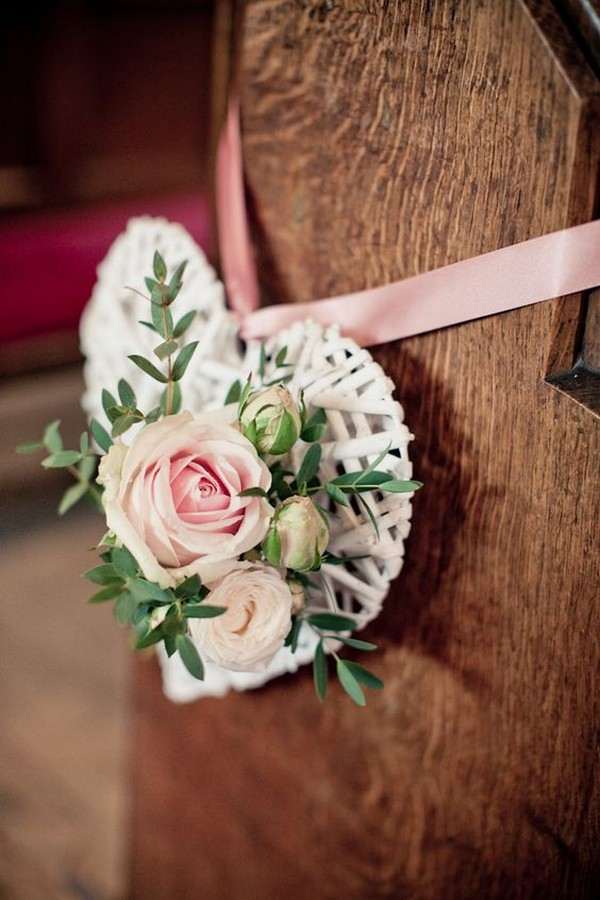 white wicker hearts decorated church wedding aisle