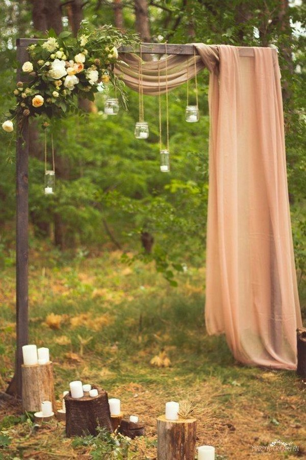boho chic wedding backdrop with candles