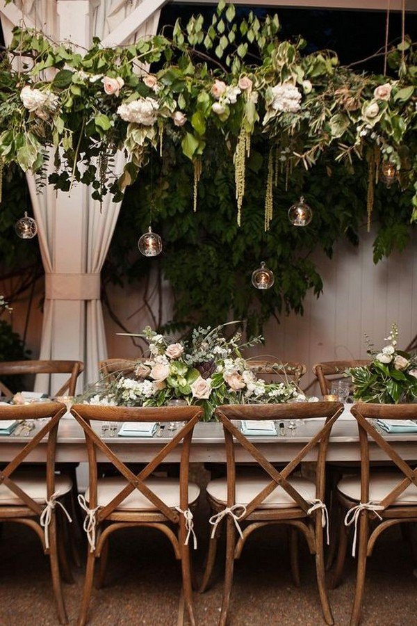 chic rustic wedding reception with hanging candles