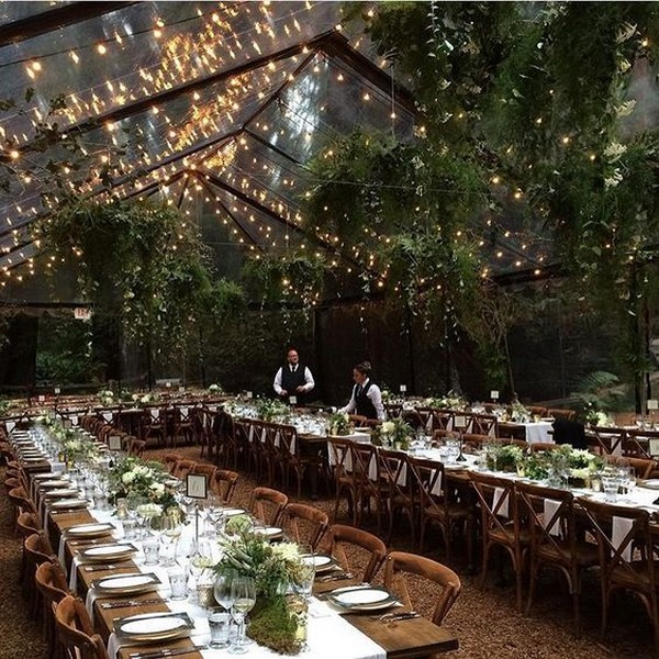 clear tent and string lights forest wedding reception