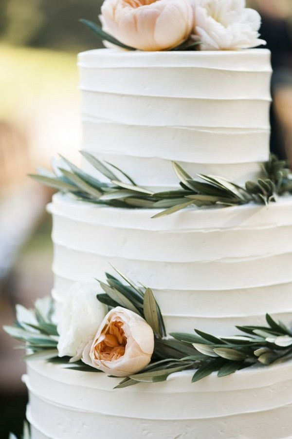 elegant white wedding cake with dusty pink floral and greenery