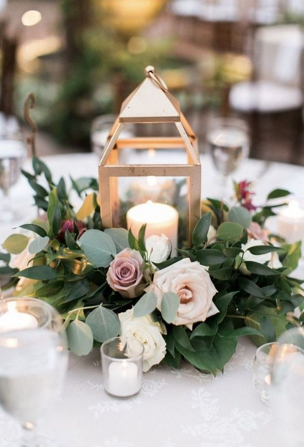 green and mauve wedding centerpiece with lantern