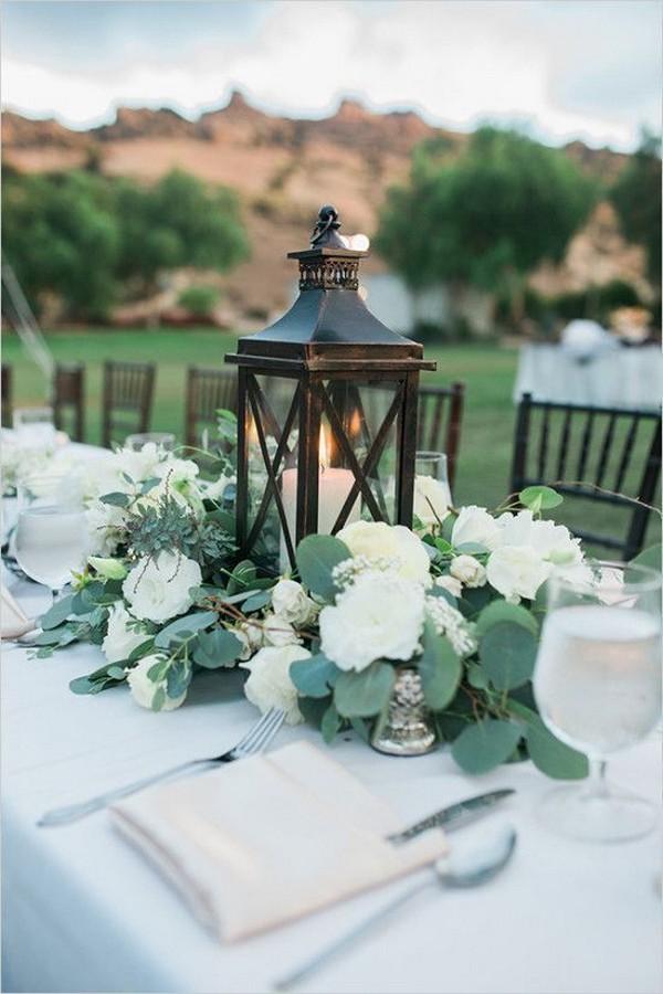 greenery and white wedding centerpiece ideas with lanterns