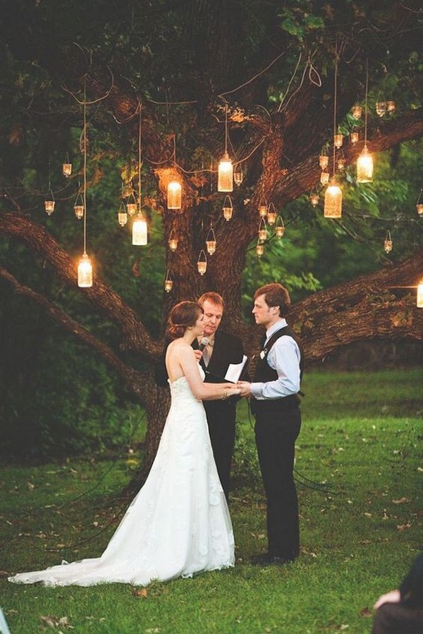 outdoor wedding backdrop with hanging candles