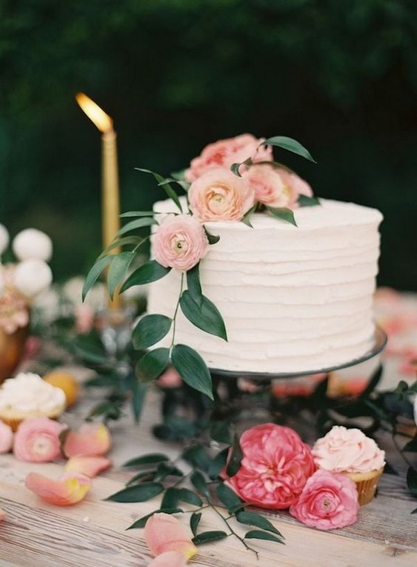 simple wedding cake with pink ranunculus