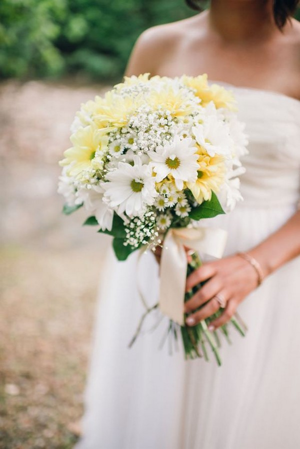 yellow and white wedding bouquet with baby's breath