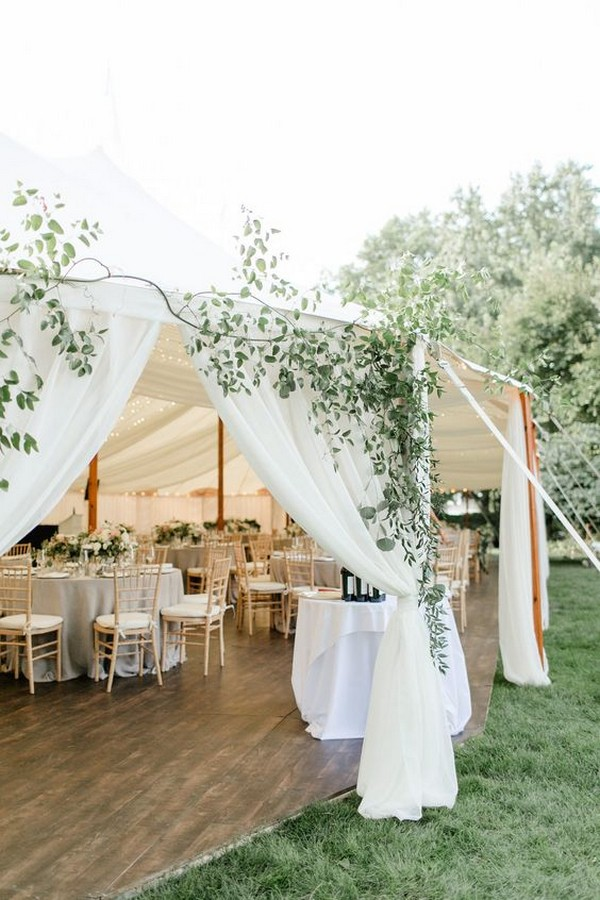 chic elegant tented wedding reception with greenery