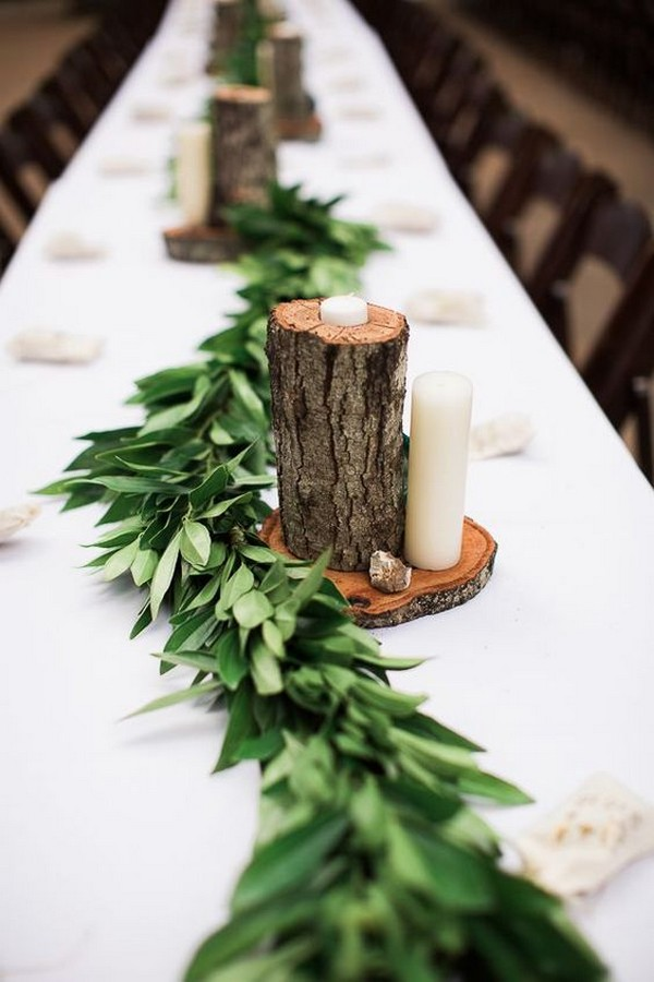 chic rustic greenery wedding garland with tree stumps