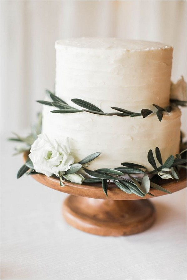chic simple wedding cake with olive leaves and white floral
