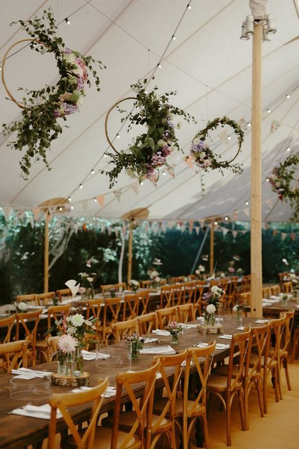 chic tented wedding reception with hanging floral hoops