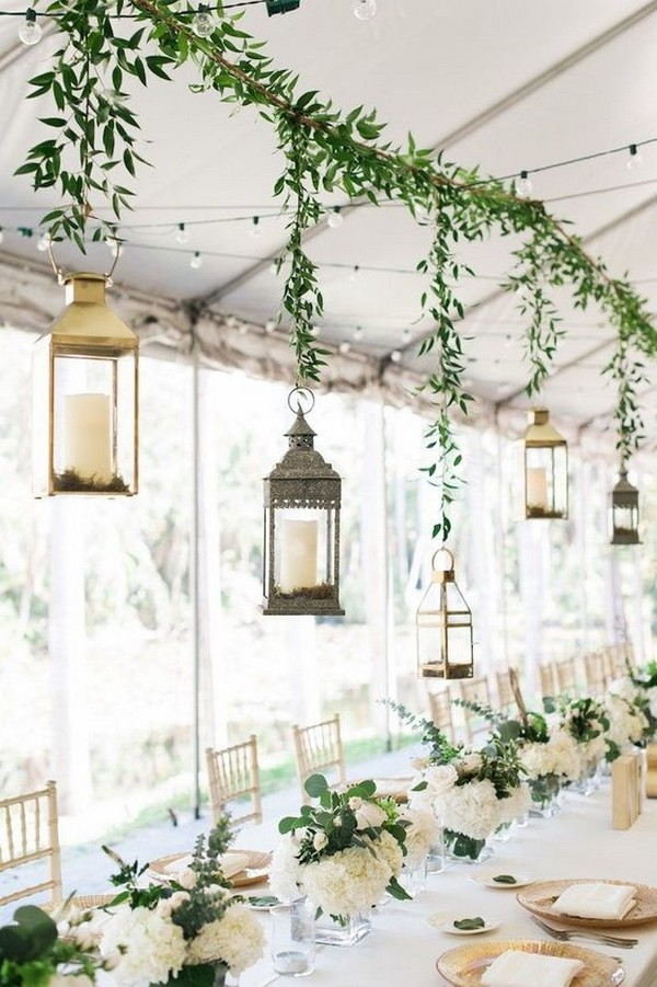 chic tented wedding reception with hanging lanterns