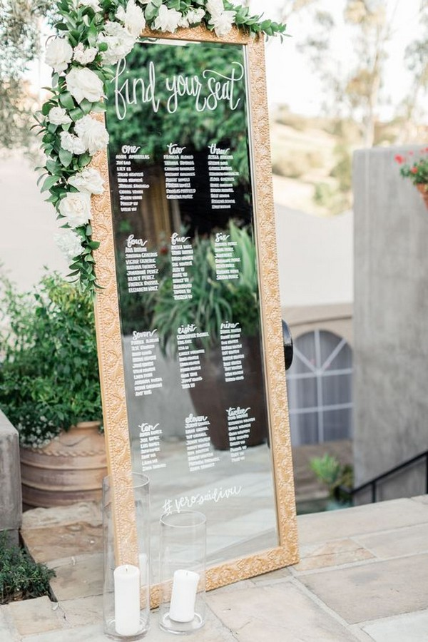 chic vintage mirror wedding seating chart with greenery