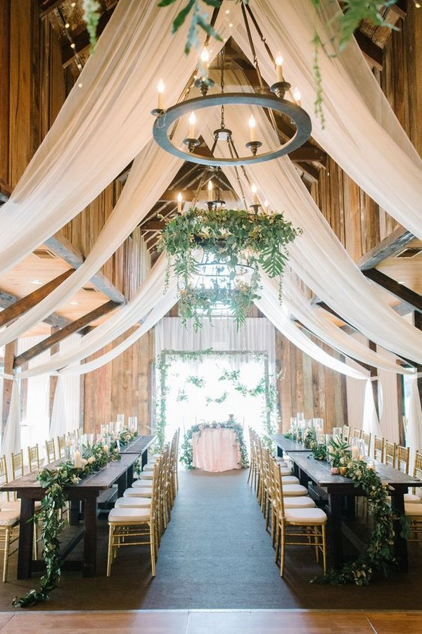 country wedding reception ideas in a barn with curtains and greenery
