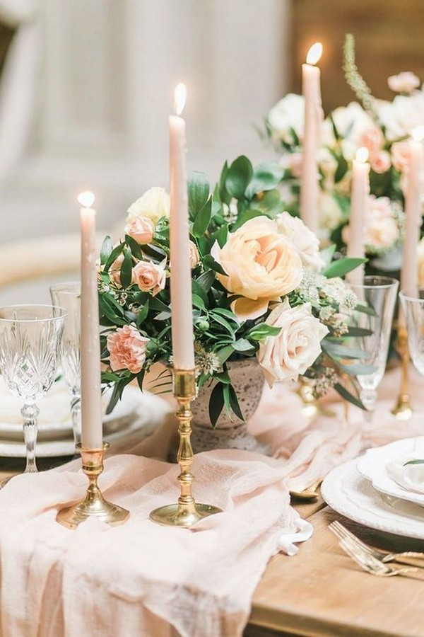elegant neutral wedding centerpiece with blush pink and greenery