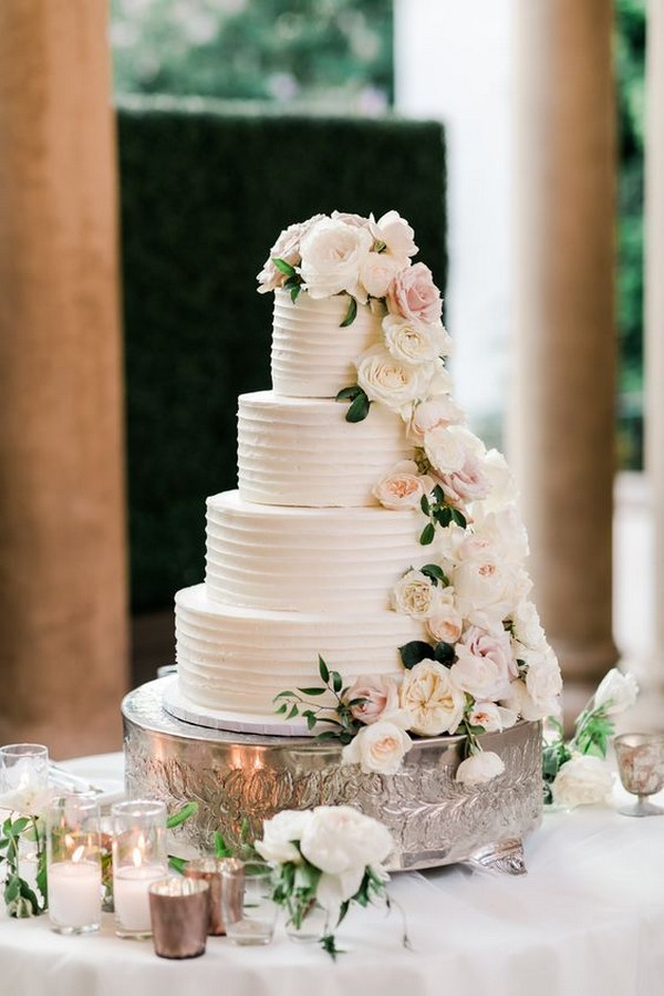 four tiered ivory wedding cake with neutral florals