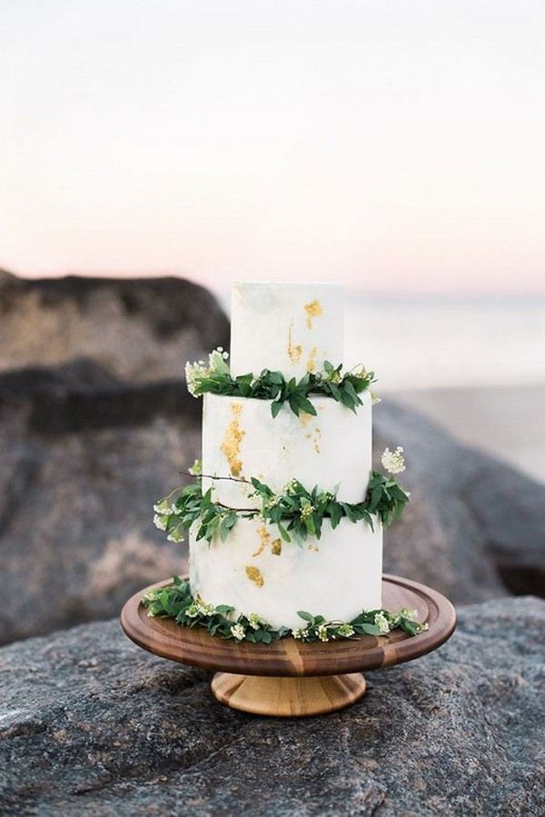 marbled wedding cake with greenery and gold