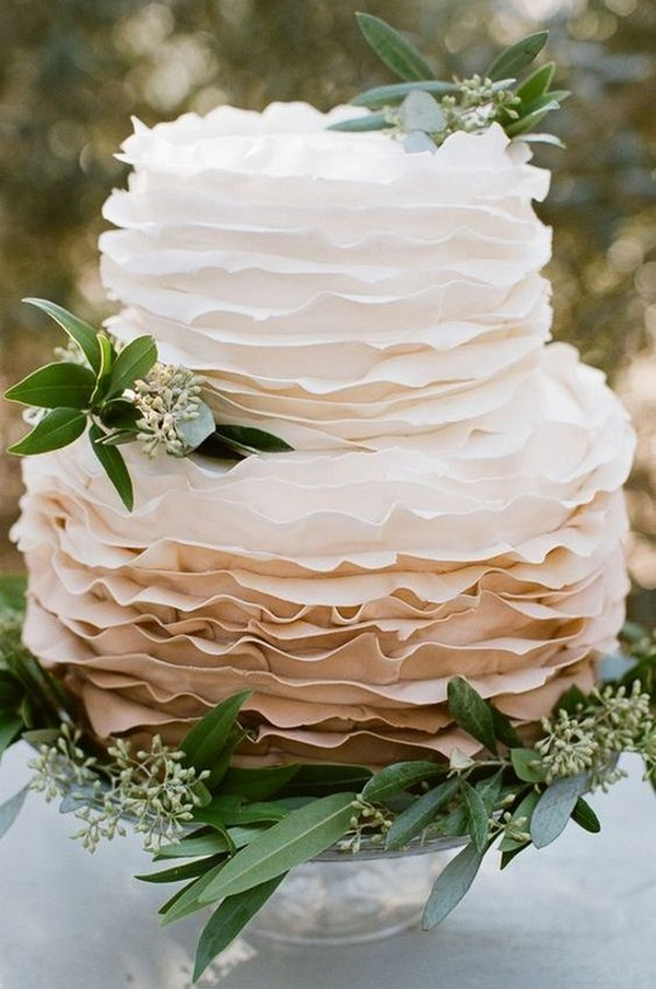 neutral colors ruffled wedding cake with olive leaves