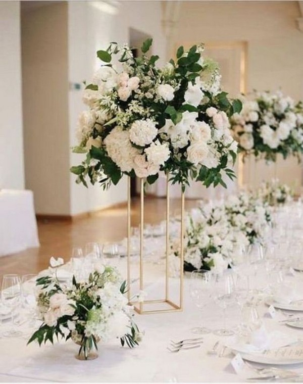 neutral industrial tall wedding centerpiece