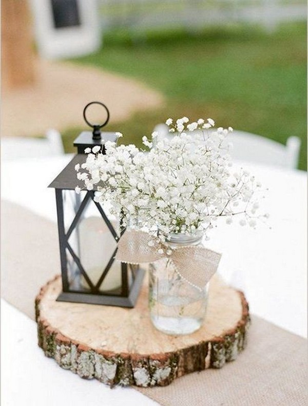 rustic wedding centerpiece with lantern and baby's breath